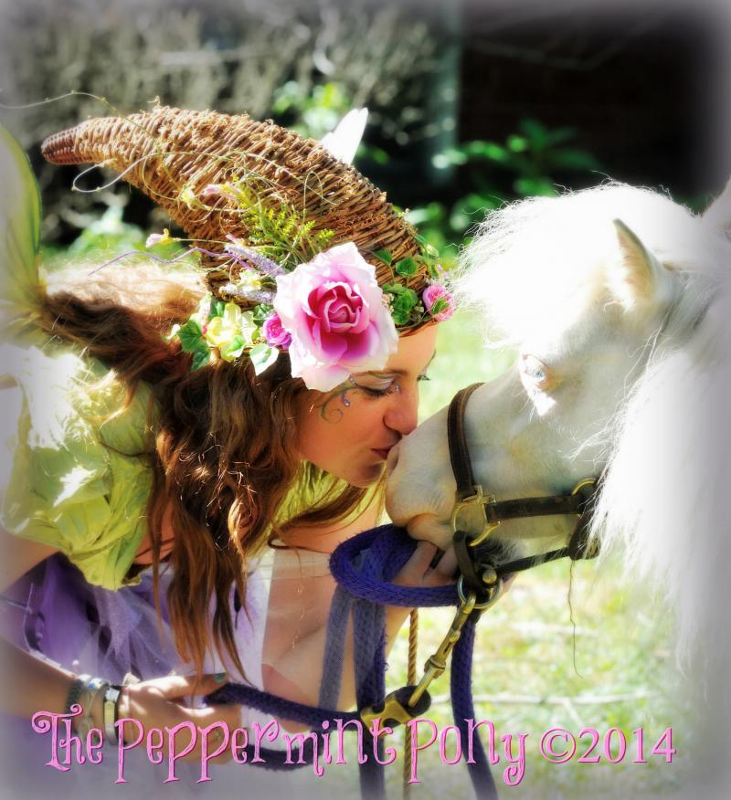 Our Faerie Erica bestowing a loving kiss upon our 30 mini horse, Easter Lily
