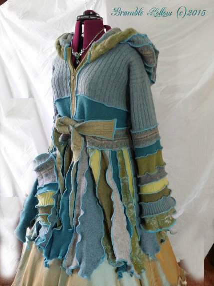 mermaid inspired sweater coat, with sculpted pixie point hem and bell sleeves